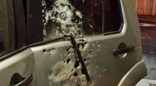 Damaged caused to a police vehicle after it was damaged by a bomb blast in Derry