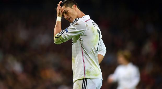 Blanked: Cristiano Ronaldo shows his frustration after being kept on a tight rein by Liverpool's defence