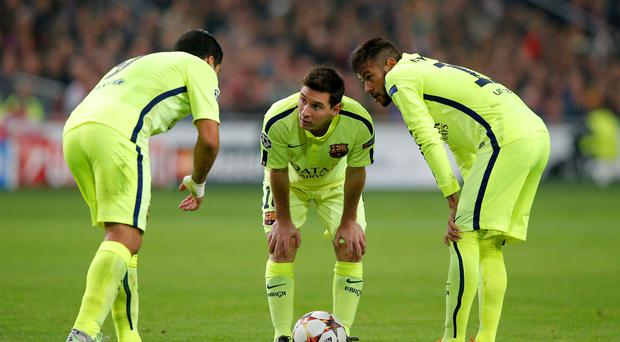 Luis Suarez, Lionel Messi and Neymar of Barcelona discuss a free kick during the UEFA Champions League Group F match between AFC Ajax and FC Barcelona at The Amsterdam Arena on November 5, 2014 in Amsterdam, Netherlands. (Photo by Dean Mouhtaropoulos/Getty Images)