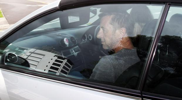 AC/DC drummer Phil Rudd leaves Tauranga District Court after being charged with attempting to procure murder at Tauranga District Court on November 6, 2014 in Tauranga, New Zealand.