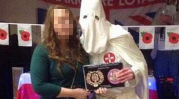 The photograph showing a man dressed as a KKK member. Pic Facebook