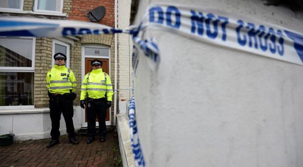 Police officers outside a house in High Wycombe after four men were arrested in connection with an alleged Islamist terror plot. Pic Andrew Matthews/PA Wire