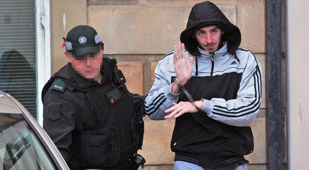 Eamon Bradley leaving at Londonderry Magistrates' Court in police custody. Pic Justin Kernoghan