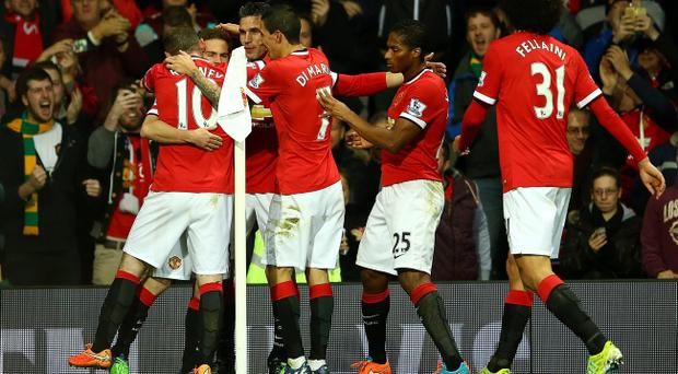 Juan Mata of Manchester United celebrates scoring the first goal with his team-mates (Photo by Richard Heathcote/Getty Images)