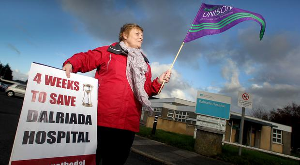A worker protests at the Dalriada hospital