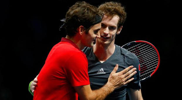 All over: Roger Federer and Andy Murray after the British number one was humbled 6-0 6-1 in London