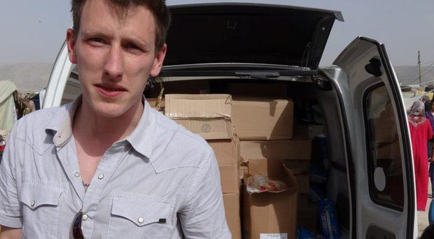 Peter Kassig standing in front of a truck filled with supplies destined for Syrian refugees
