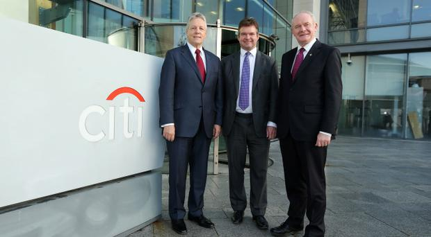 First Minister Peter Robinson and Deputy First Minister Martin McGuinness are pictured with James Bardrick, Citi Country Officer, United Kingdom. Pic Kelvin Boyes