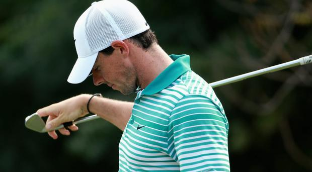 Rory McIlroy of Northern Ireland selects a club on the fourth hole during the second round of the DP World Tour Championship at Jumeirah Golf Estates on November 21, 2014 in Dubai, United Arab Emirates. (Photo by Warren Little/Getty Images)