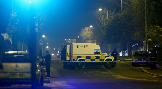 Police officers at the scenes of an incident close to a bar on the Cliftonville Road in North Belfast. Photo: Kevin Scott