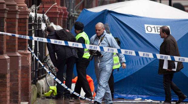 A police forensic tent outside the house where two men died when a balcony collapsed