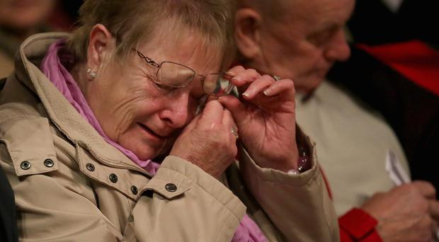 A woman weeps at a memorial service and vigil at Birmingham Cathedral last night to mark 40 years since the Birmingham pub bombings on November 21, 1974. Twenty-one people were killed and 182 injured in the IRA attack