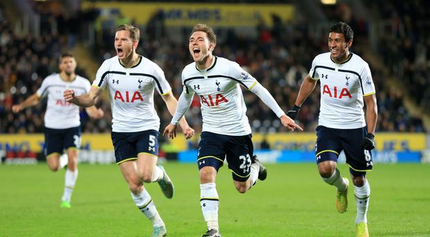 Tottenham Hotspur's Christian Eriksen (centre) celebrates scoring the winner with team-mates Jan Vertonghen and Paulinho (right) during the Barclays Premier League match at the KC Stadium, Hull. Lynne Cameron/PA Wire.