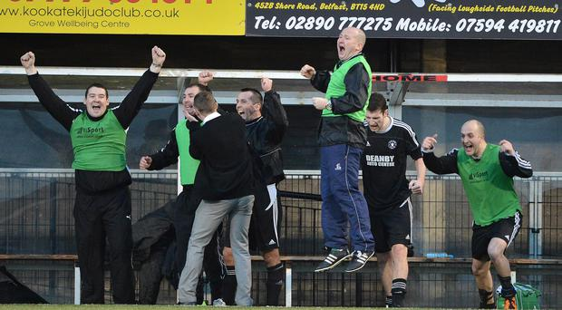 Crumlin Star manager Sean Brown jumps highest as he celebrates their second successive Border Cup triumph (against Rathfriland Rangers) at Seaview in 2012