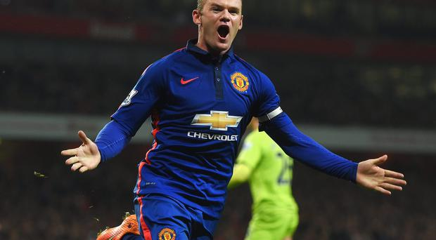 Victory salute: Wayne Rooney celebrates after scoring Manchester United's decisive second goal