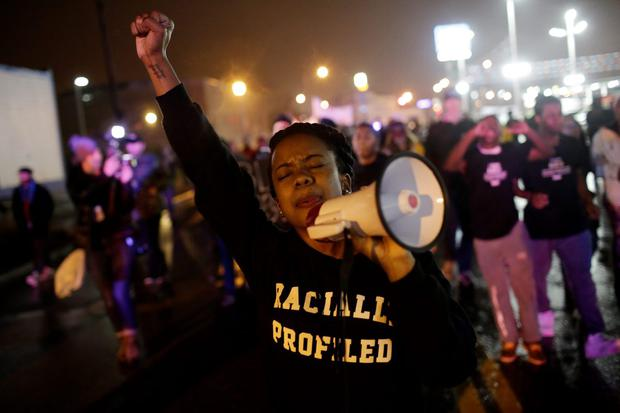Demonstrators protest the shooting death of Michael Brown November 23, 2014 in St. Louis, Missouri. (Photo by Joshua Lott/Getty Images)