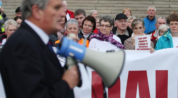 Health Minister Jim Wells address protesters outside Parliament Buildings, Stormont, concerned about the closure of the Dalriada Hospital. Picture by Brian Little/ Presseye