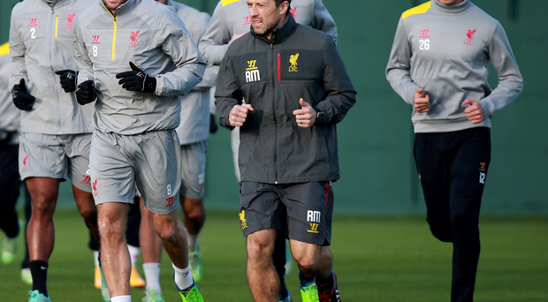 Under pressure: Steven Gerrard leads a Liverpool training session yesterday