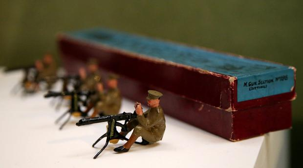 Toy Soldiers: Wartime games for children often reflected the times in which they lived. This machine gun section of six soldiers was made by well-known model makers William Britain of London. Other wartime toys included strategy board games and teddy bears with military themed uniforms