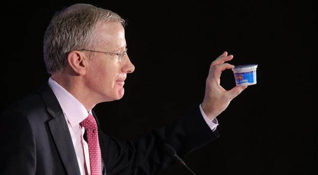 Gregory Campbell holds a yogurt during his speech at the DUP conference