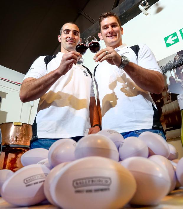 Raising a glass: Ruan Pienaar and Robbie Diack toast the launch of their new wine brand, Ballybosch
