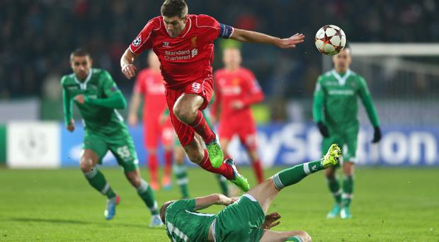 No way through: Liverpool's Steven Gerrard is blocked by Cosmin Moti of Ludogorets