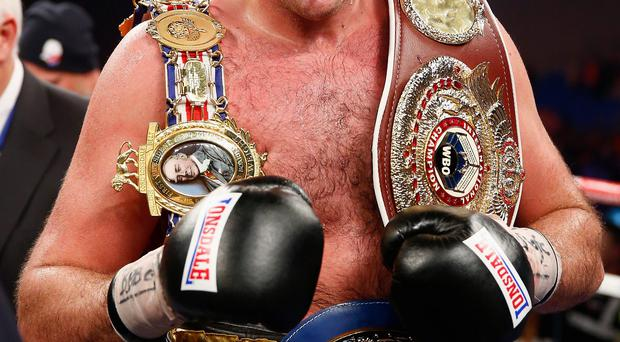 Taste for success: Tyson Fury celebrates victory over Dereck Chosora