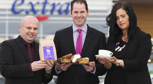 Celebrating the good news that Ground Espresso Bars is opening at Tesco Extra in Banbridge is (l-r) Dermot McGrath, area manager Ground Espresso Bars, Stephen Magill, manager of Tesco Extra and Csilla Bertok, manager Ground Espresso Bars