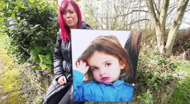 Andrea McAleese, with a picture of her beloved daughter Roma who died five years ago