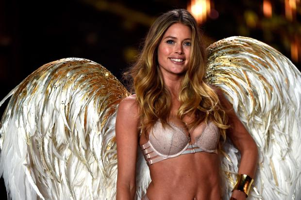 LONDON, ENGLAND - DECEMBER 02: Model Doutzen Kroes walks the runway at the annual Victoria's Secret fashion show at Earls Court on December 2, 2014 in London, England. (Photo by Pascal Le Segretain/Getty Images)