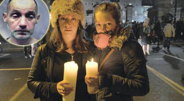 Ellen Whelan and Cathy McGuinness from Arklow, Co Wicklow, attend a candlelight ceremony in memory of homeless man Jonathan Corrie (inset) outside Leinster House in Dublin. Photo: Barbara Lindberg