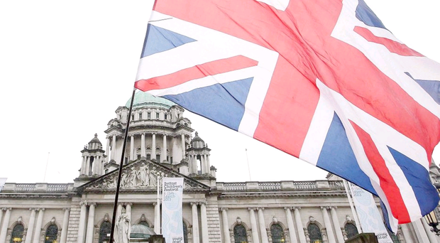 A small group of loyalists marked the second anniversary of the decision to restrict the flying of the Union flag at Belfast City Hall with a protest last night
