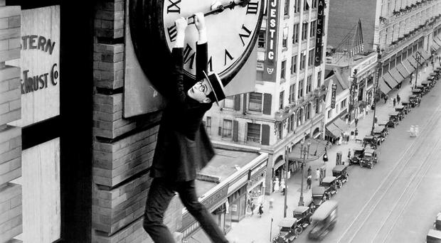 Silent movie star Harold Lloyd hangs on grimly to hour hand of a clock. Time is also running out for our politicians over corporation tax powers, which are dependent on them agreeing a budget for 2015/16, implementing welfare reform and settling our outstanding legacy issues