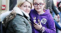 One Direction fans queue up in Belfast City Centre for concert tickets. Zoe Buchanan and her daughter Katie(10). Photo: Jonathan Porter / Press Eye