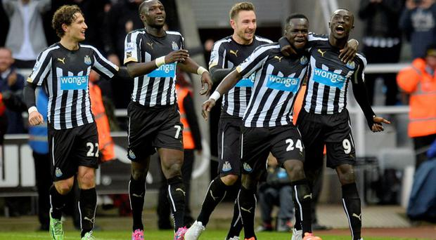 Newcastle United's Papiss Demba Cisse (right) celebrates with his team-mates after scoring his side's second against Chelsea