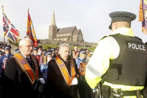 Members of Portadown District mark 6,000 days of their protest yesterday against being banned from parading from Drumcree Church to the Orange hall in the town centre. Their traditional return procession was banned by the Parades Commission in July 1998