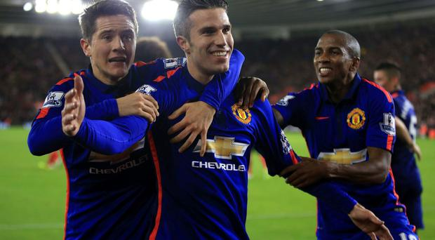 Robin van Persie celebrates with teammates Ander Herrera and Ashley Young after scoring Manchester United's winning goal in their Premier League clash with Southampton at St Mary's