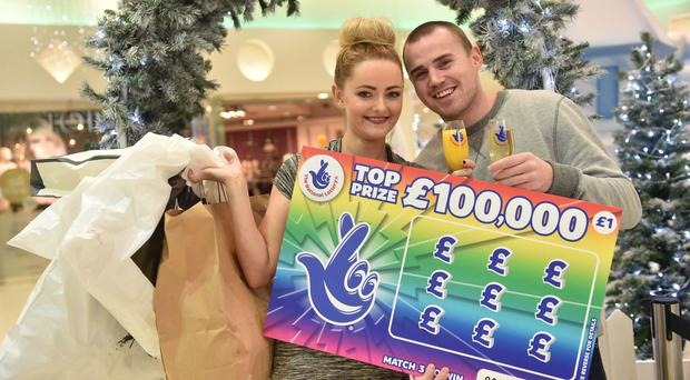 Lauren McLarnon (23) from Newtownabbey on a shopping trip with her partner, Michael Mullen (25), after she won £100k on a National Lottery Scratchcard