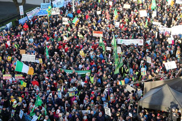 Crowds gather for the Right2Water anti water charges protest, outside Leinster House in Dublin. Niall Carson/PA Wire