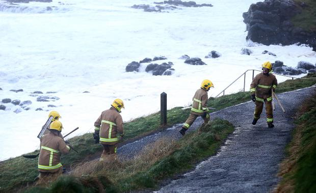 Fire fighters working to secure a house close to the cliff on Strand Road in Portstewart