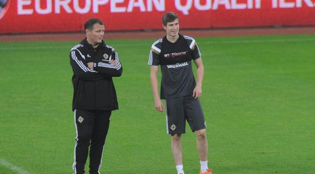 Watching brief: Irish FA coach Jim Magilton and Paddy McNair look on during a Northern Ireland training session
