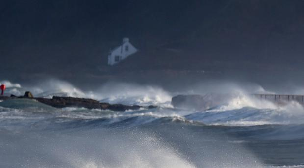 Professional surfer Alastair Mennie braves the conditions as he catches a wave on December 10, in Ballycastle