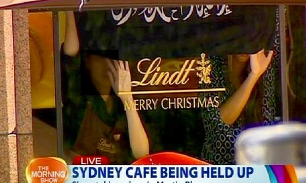 A TV still showing the Lindt Cafe in Sydney reportedly under siege. Photograph: Channel 7