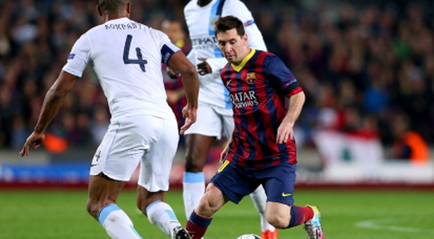 Little wizard: Lionel Messi takes on Vincent Kompany as Barca progress against City last year