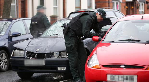 Tuesday 16th December 2014, Belfast. Pictured is police officers at the scene of the RTC in West Belfast Picture Credit. Kevin Scott