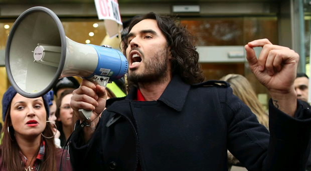Security staff were forced to close RBS' London offices after Russell Brand marched into the lobby with a megaphone and camera crew