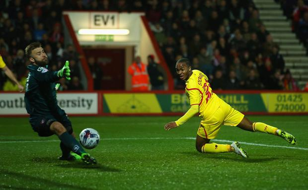 Raheem Sterling of Liverpool scores the opening goal during the Capital One Cup Quarter-Final match (Photo by Bryn Lennon/Getty Images)