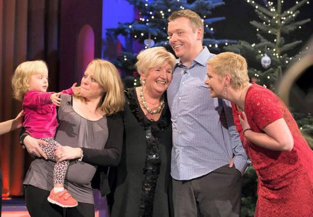 Madeline Quann (centre) from Skerries as she and her daughter Suzanne (right) are reunited with her son Gareth Quann, his wife Jackie and two-year-old daughter Sadhbh through the Supermac's Bring Them Home campaign on The Late Late Show last year
