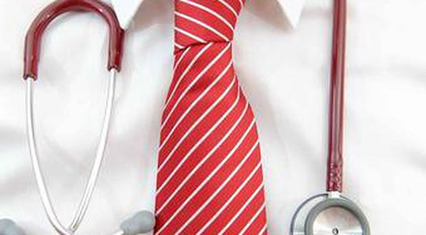 The number of GP surgeries has dropped to a 25-year low putting patient care in Northern Ireland at risk, leading doctors have warned.