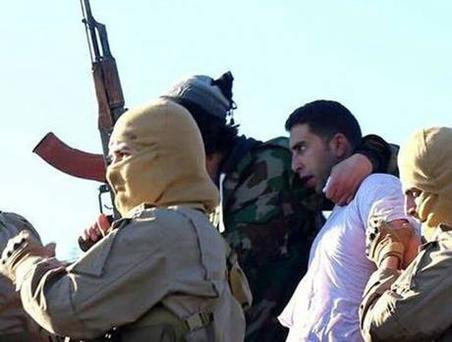 Members of the Islamic State group with a captured pilot